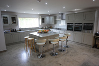 painted oak, granite surfaces, leather handles, the perfect combination